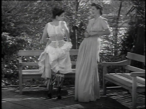 vidéos et rushes de 1939 montage women taking off robes to show off old-fashioned and modern undergarments / new york city, new york, united states - 1930
