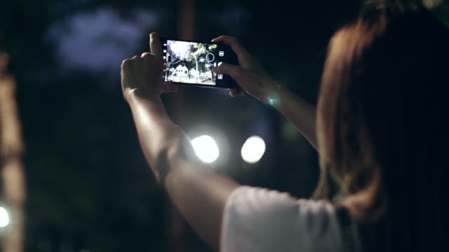 Women Taking Photo With Smart Phone At Night