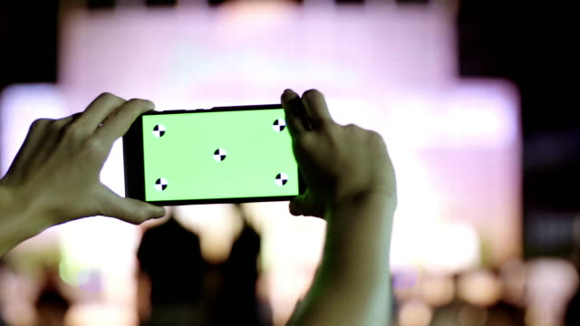 Women Taking Photo With Smart Phone In a Party At Night, Green Screen