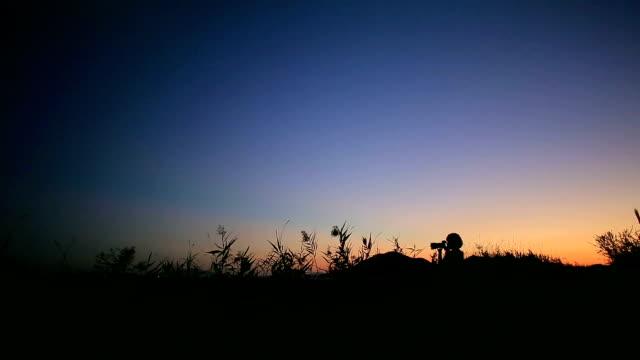 Women taking photograph in Suncheonman Bay(Natural Landmark,Ecological Park) at sunset