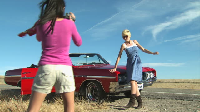 women taking pictures on the side of the road - see other clips from this shoot 1138 stock videos and b-roll footage