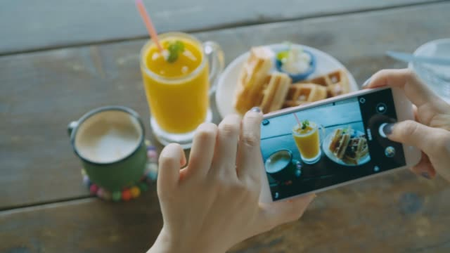 women taking shots of food - photographing stock videos & royalty-free footage