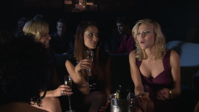 ms zi women talking and having drinks in bar / london, uk - hands covering mouth stock videos and b-roll footage
