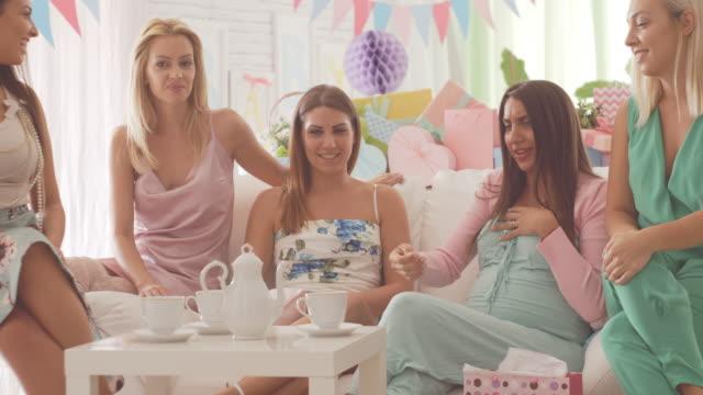 women talking on baby shower - baby shower video stock e b–roll