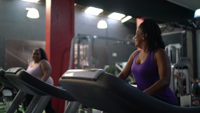 women talking on treadmill at the gym - active lifestyle stock videos & royalty-free footage