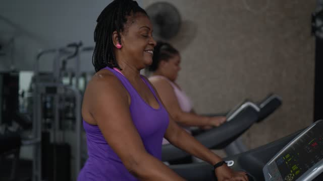 women talking on treadmill at the gym - cardiovascular exercise stock videos & royalty-free footage