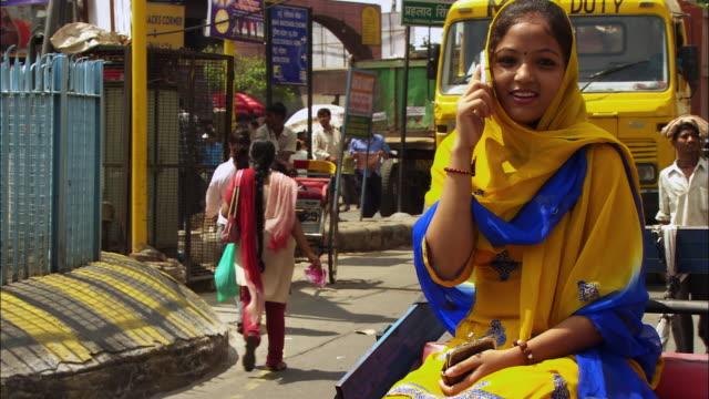 a women talks on her mobile phone. available in hd. - ペディキャブ点の映像素材/bロール