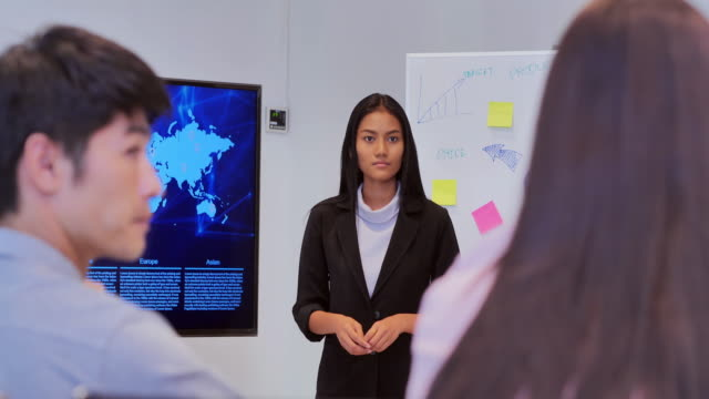 women team leader presenting project strategy showing ideas on digital interactive whiteboard in office presentation diverse colleagues enjoying training seminar.business,people,success,leadership,teamwork,high-tech meetings and technology concept - interactive whiteboard stock videos & royalty-free footage