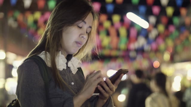 women texting on a smartphone at night - internet dating stock videos and b-roll footage