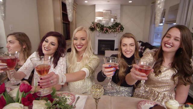 women toasting at a holiday christmas party - gold dress stock videos & royalty-free footage
