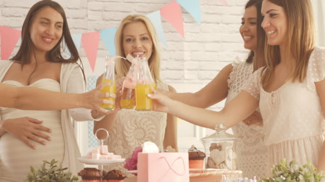 women toasting with drinks at baby shower party - baby shower stock videos and b-roll footage