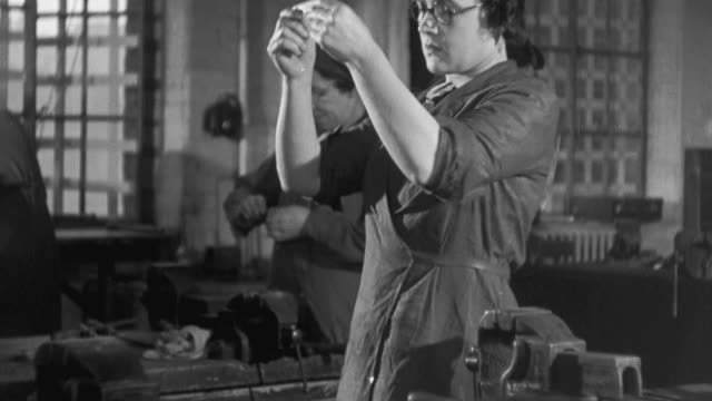 1941 MONTAGE Women training at technical college, working on lathes, ironing, metal files and a sewing machine and eating together / United Kingdom