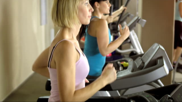 women training in the gym - exercise machine stock videos & royalty-free footage