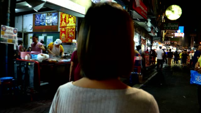 Women travelling in bangkok china town at night