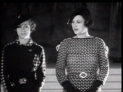 b/w 1934 2 women turning modeling 1935 winter fashions / new york city - 1935 stock videos & royalty-free footage