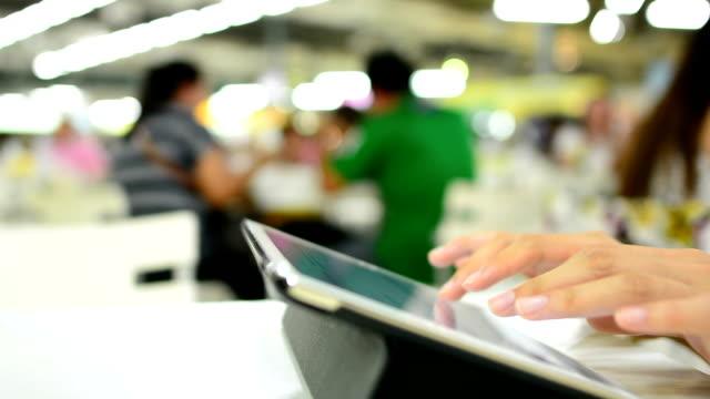 Women typing tablet