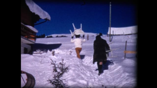 1969 women unloading car and carrying furniture up snowy path - relocation stock videos & royalty-free footage