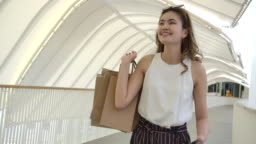 Women use paper bags for shopping in bangkok thailand.