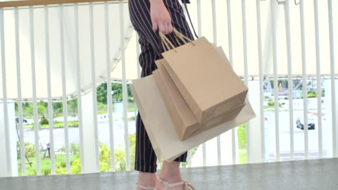 women use paper bags for shopping in bangkok thailand. - paper bag stock videos & royalty-free footage