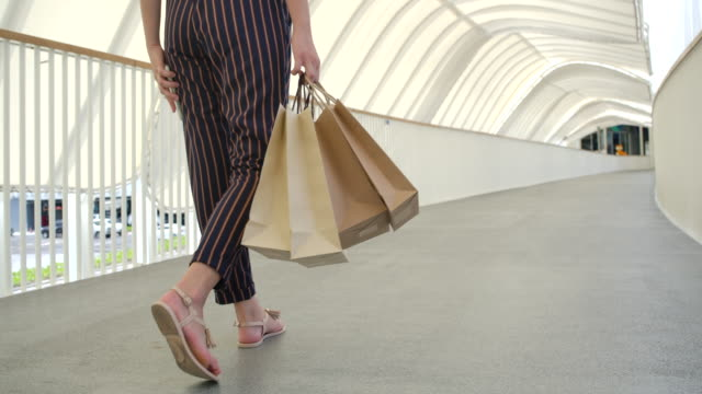 women use paper bags for shopping. - reusable bag stock videos & royalty-free footage