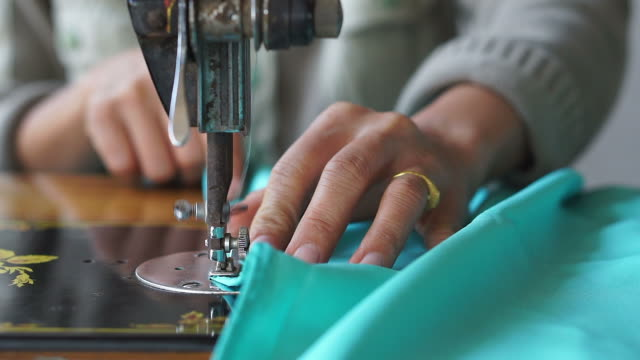 women use sewing machine. - sewing stock videos and b-roll footage