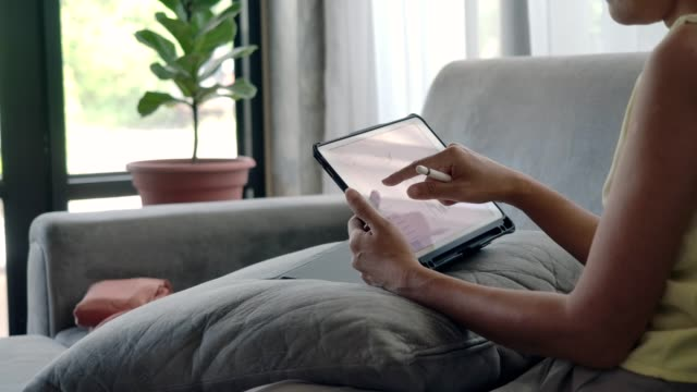 women use tablet for working at home. - hot desking stock videos & royalty-free footage