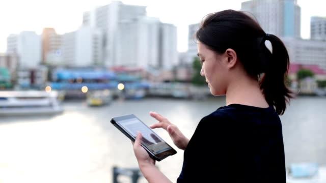 Women use Tablet