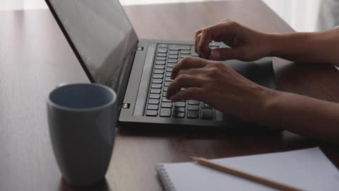 women uses laptop keyboard and finishes her job by closing the lid - laptop stock videos & royalty-free footage