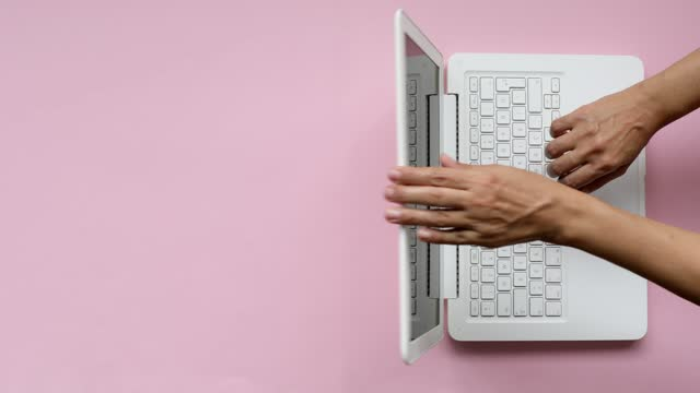 women uses laptop keyboard and finishes her job by closing the lid - top view - typing stock videos & royalty-free footage