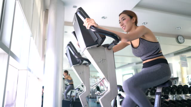 women using exercise machines - cross trainer stock videos and b-roll footage