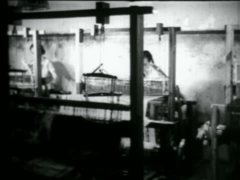 b/w 1934 2 women using looms in wpa weaving project / documentary - 雇用促進局点の映像素材/bロール