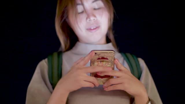 vídeos de stock e filmes b-roll de women using mobile phone at night - só mulheres de idade mediana