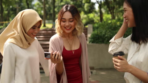 women using phones after shopping - asian and indian ethnicities stock videos & royalty-free footage