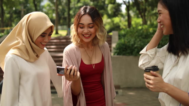 women using phones after shopping - headscarf stock videos & royalty-free footage
