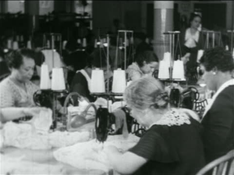 b/w 1934 women using sewing machines in wpa garment factory / documentary - 1934 stock videos & royalty-free footage