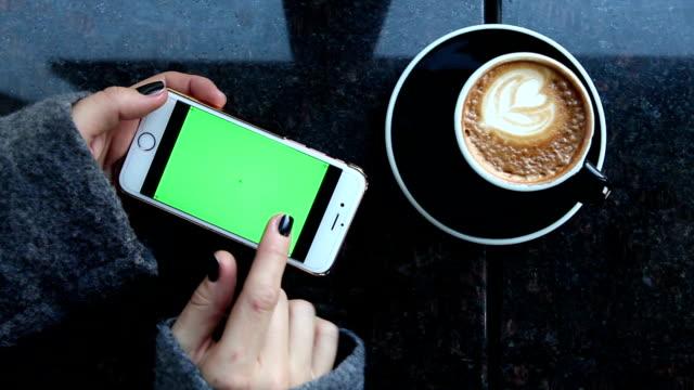 women using smart phone with green screen