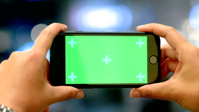 cu : women using smart phone with green screen - photography stock videos & royalty-free footage