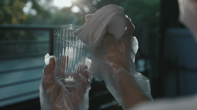 women using spray alcohol for cleaning - glove stock videos & royalty-free footage