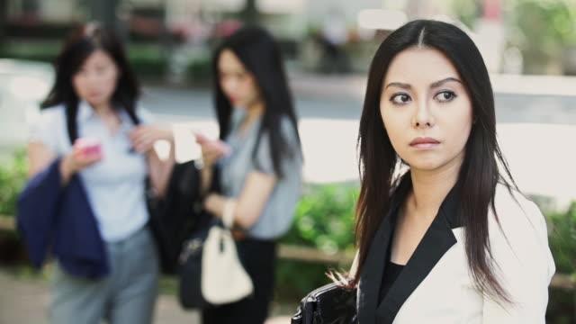 Women Waiting Anxiously on Tokyo Street