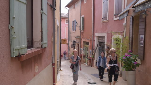 women walk in old town alley in ochre village roussillon - luberon stock videos & royalty-free footage
