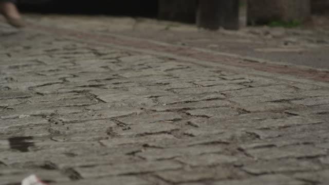 women walking along brick road - uneven stock videos & royalty-free footage