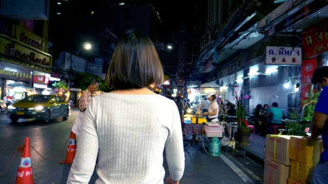 Women walking at night in Bangkok