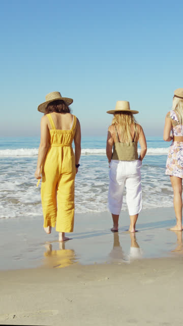 women walking at the beach - walking in water stock videos & royalty-free footage