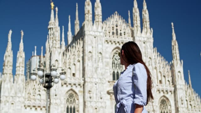 women walking at the milan cathedral - piazza del duomo milan stock videos and b-roll footage