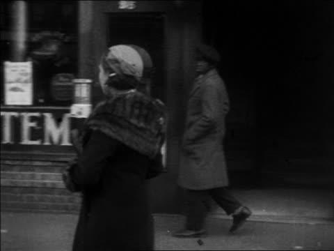 b/w 1930 pan 2 women walking by 2 black men on harlem sidewalk / nyc / newsreel - 1930 stock videos & royalty-free footage