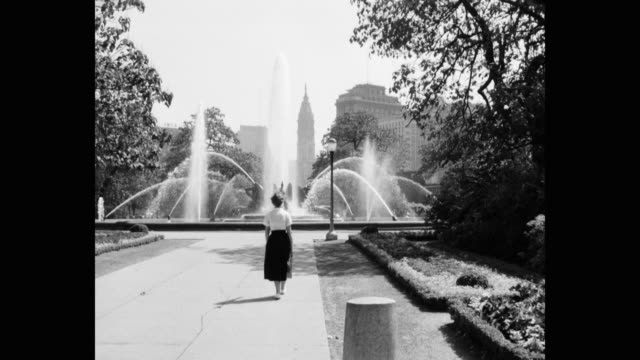 women walking in park towards swann memorial fountain, philadelphia, pennsylvania, usa - swann memorial fountain stock videos & royalty-free footage