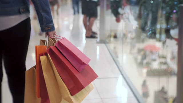 women walking in shopping mall, sale, consumerism: - shopping bag stock videos & royalty-free footage