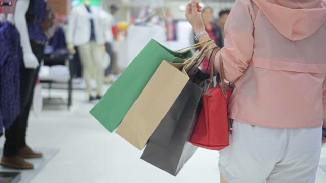 women walking in shopping mall - shopping bag stock videos & royalty-free footage