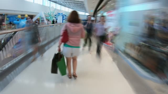 women walking in shopping mall,hyperlapse - shopping bag stock videos and b-roll footage