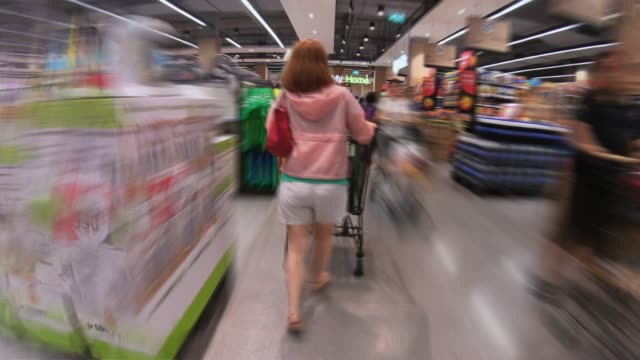 women walking in supermarket,hyperlapse - supermarket stock videos & royalty-free footage